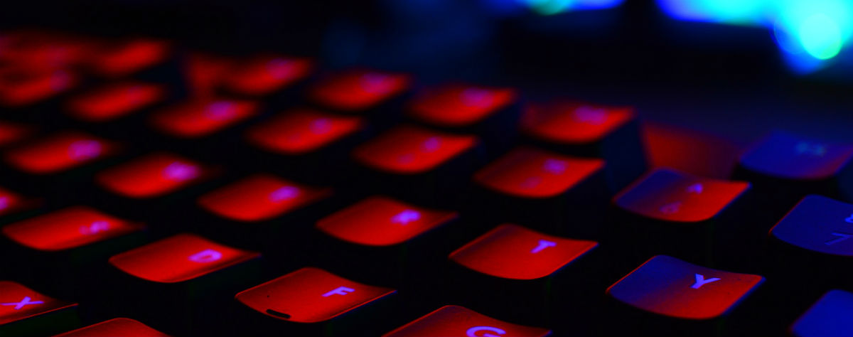 A computer keyboard, lit in red